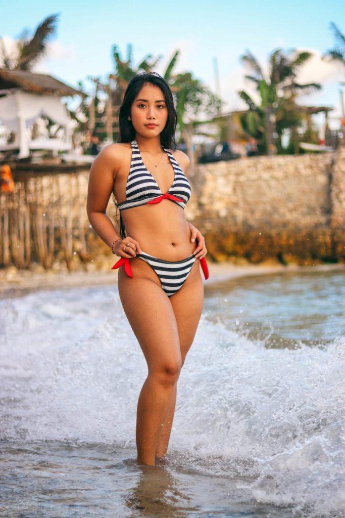 Natural Philippine woman at the beach in Bikini